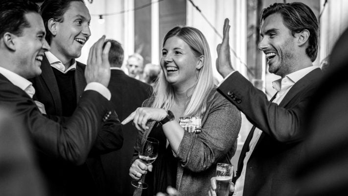 outdoor corporate event photography surrey country mansion tent people having fun networking black-white image