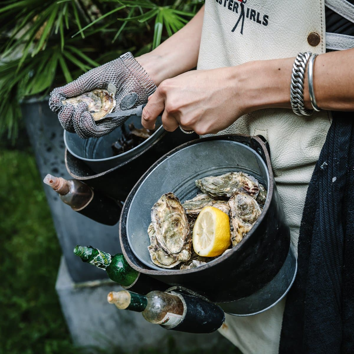 outdoor corporate event photography surrey detail shot oyster bar lady preparing