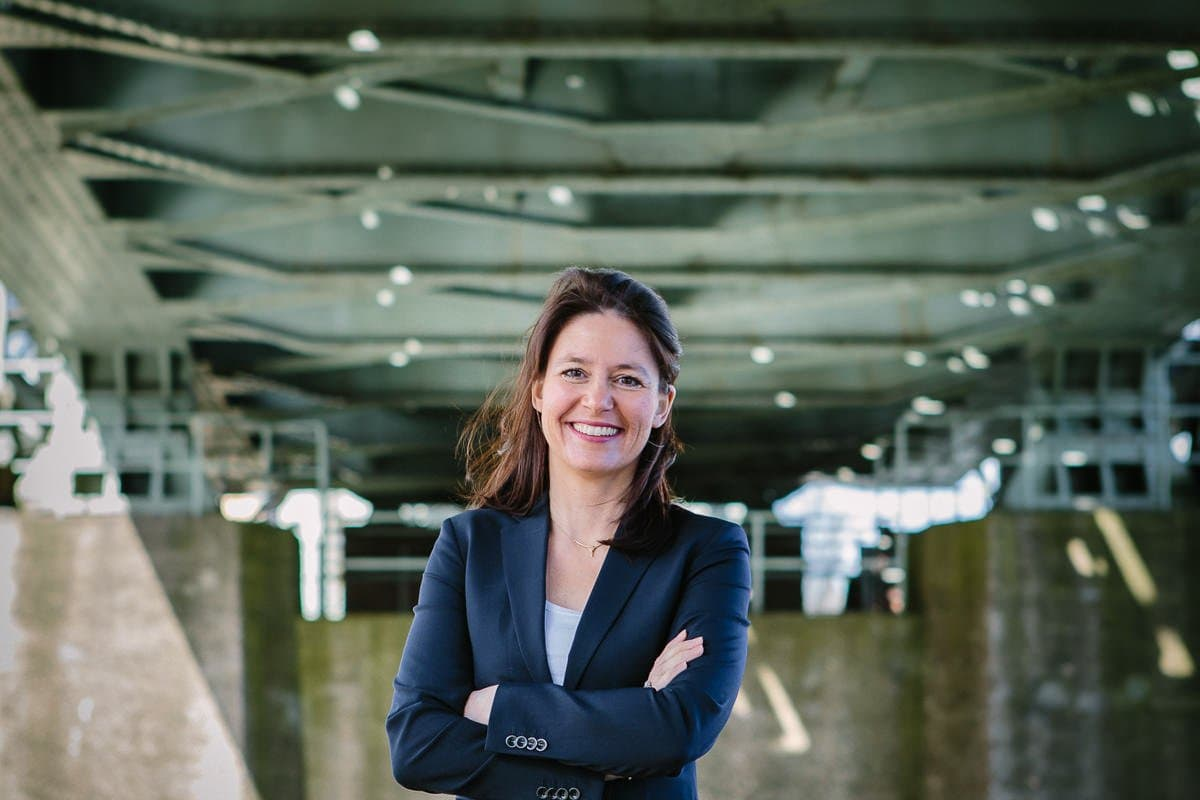 personal branding photo professional headshot lady entrepreneur lawyer barrister attorney outdoor image green steel bridge natural light