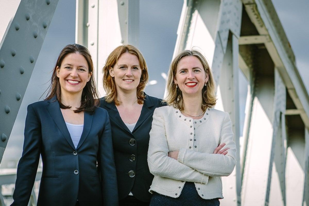 personal branding photo three lady entrepreneurs attorneys barristers lawyers walking outdoor image steel bridge brand photo